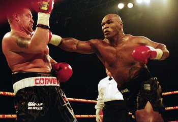 13 Oct 2001:  Mike Tyson of the USA lands a punch on opponent Brian Nielsen of Denmark during the world heavyweight fight at the Parken Stadium in Copenhagen, Denmark.  Tyson won the bout after the Referee stopped the fight in the 7th Round. \ Mandatory C