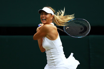LONDON, ENGLAND - JUNE 30:  Maria Sharapova of Russia in action during her semifinal round match against  Sabine Lisicki of Germany on Day Ten of the Wimbledon Lawn Tennis Championships at the All England Lawn Tennis and Croquet Club on June 30, 2011 in L