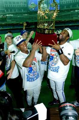 Rockey Henderson, Joe Carter and World Series trophy