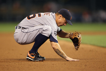 KANSAS CITY, MO - JULY 07:  Brandon Inge #15 of the Detroit Tigers rubs the dirt during the game against the Kansas City Royals on July 7, 2011 at Kauffman Stadium in Kansas City, Missouri.  (Photo by Jamie Squire/Getty Images)