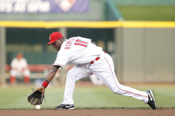 CINCINNATI, OH - JULY 16: Edgar Renteria #16 of the Cincinnati Reds fields a ground ball during the game against the St. Louis Cardinals at Great American Ball Park on July 16, 2011 in Cincinnati, Ohio. The Cardinals won 4-1. (Photo by Joe Robbins/Getty I