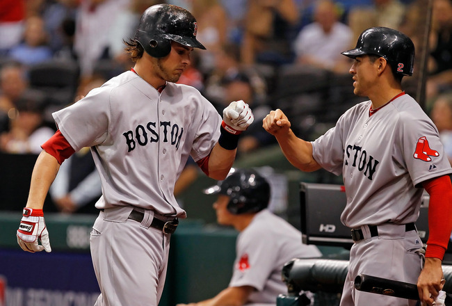 ST. PETERSBURG, FL - JULY 16:  Outfielder Josh Reddick #16 of the Boston Red Sox is congratulated by Jacoby Ellsbury #2 after his two run home run against the Tampa Bay Rays during the game at Tropicana Field on July 16, 2011 in St. Petersburg, Florida.