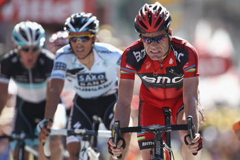 PINEROLO, ITALY - JULY 20:  Cadel Evans (R) of Australia and BMC Racing Team crosses the finishing line alongside Alberto Contador (C) of Spain and Saxo Bank Sungard and Andy Schleck (L) of Luxemburg and Team Leopard-Trek during Stage 17 of the 2011 Tour
