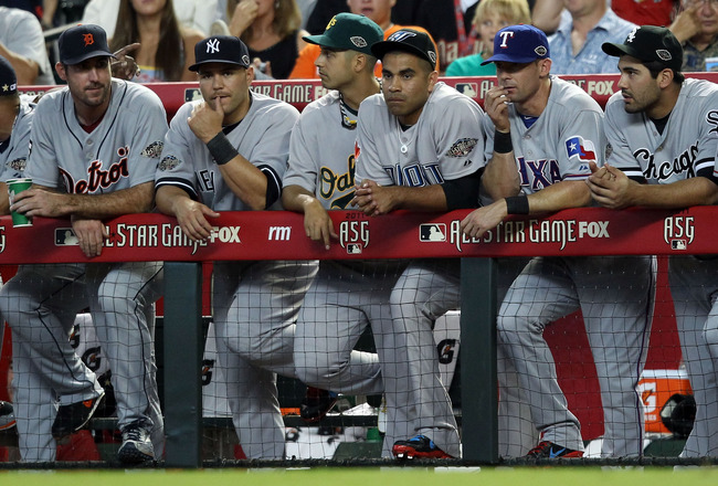 PHOENIX, AZ - JULY 12:  The American League players stand in the dugout during the 82nd MLB All-Star Game at Chase Field on July 12, 2011 in Phoenix, Arizona.  (Photo by Christian Petersen/Getty Images)