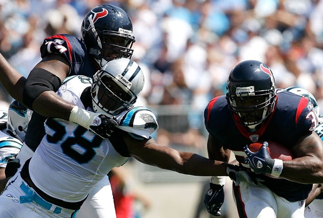 CHARLOTTE, NC - SEPTEMBER 16:  Running back Ahman Green #30 of the Houston Texans rushes away from linebacker Thomas Davis #58 of the Carolina Panthers during the first half at Bank of America Stadium on September 16, 2007 in Charlotte, North Carolina.  (