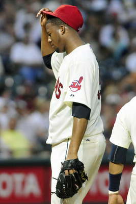 CLEVELAND, OH - JUNE 4: Fausto Carmona #55 of the Cleveland Indians reacts after giving up a two run home run during the seventh inning against the Texas Rangers at Progressive Field on June 4, 2011 in Cleveland, Ohio. The Rangers defeated the Indians 4-0