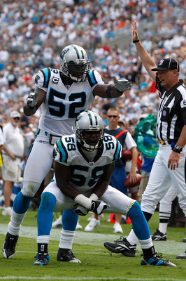 CHARLOTTE, NC - SEPTEMBER 14:  Thomas Davis #58 and teammate Jon Beason #52 of the Carolina Panthers celebrate after a defensive stop against the Chicago Bears during their game at Bank of America Stadium on September 14, 2008 in Charlotte, North Carolina