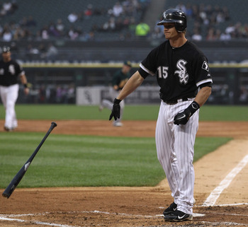 CHICAGO, IL - JUNE 10: Gordon Beckham #15 of the Chicago White Sox throws his bat after striking out with the bases loaded against the Oakland Athletics at U.S. Cellular Field on June 10, 2011 in Chicago, Illinois. The Athletics defeated the White Sox 7-5