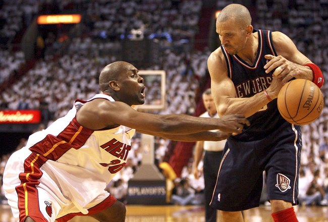MIAMI - MAY 16:  Jason Kidd #5 of the New Jersey Nets has the ball knocked out of his hands by Gary Payton #20 of the Miami Heat in game five of the Eastern Conference Semifinals during the 2006 NBA Playoffs on May 16, 2006 at the American Airlines Arena