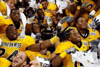NEW ORLEANS - DECEMBER 21: Members of the Southern Mississippi Golden Eagles celebrate after defeating the Troy Trojans in overtime to win the R+L Carriers New Orleans Bowl on December 21, 2008 at the Superdome in New Orleans, Louisiana. (Photo by Chris G