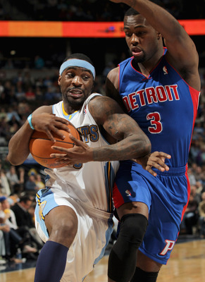 DENVER, CO - MARCH 12:  Ty Lawson #3 of the Denver Nuggets drives to the basket against the defense of Rodney Stuckey #3 of the Detroit Pistons at the Pepsi Center on March 12, 2011 in Denver, Colorado. The Nuggets defeated the Pistons 131-101.  NOTE TO U