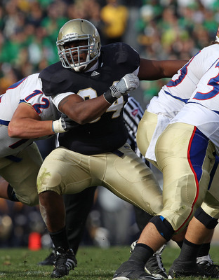 SOUTH BEND, IN - OCTOBER 30: Hafis Williams #94 of the Notre Dame Fighting Irish rushes past Clint Anderson #72 of the Tulsa Golden Hurricane at Notre Dame Stadium on October 30, 2010 in South Bend, Indiana. Tulsa defeated Notre Dame 28-27. (Photo by Jona