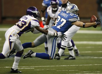 DETROIT - DECEMBER 10:  Mike Furrey #87 of the  Detroit Lions can't pull in a diving catch in front of Cedric Griffin #23 of the Minnesota Vikings on December 10, 2006 at Ford Field in Detroit, Michigan. The Vikings defeated the Lions 30-20.  (Photo by Gr
