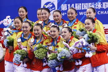 SHANGHAI, CHINA - JULY 21:  The People's Republic of China team celebrate winning the silver medal in the Synchronized Swimming Free Combination Final during Day Six of the 14th FINA World Championships at the Oriental Sports Center on July 21, 2011 in Sh