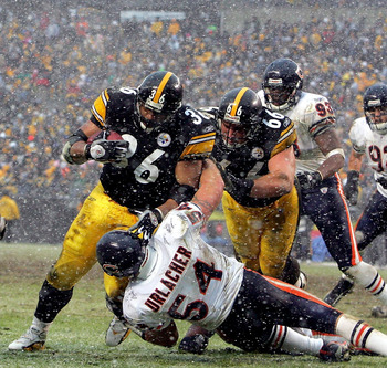 PITTSBURGH - DECEMBER 11:  Jerome Bettis #36 of the Pittsburgh Steelers runs over Brian Urlacher #54 the Chicago Bears for a touchdown on December 11, 2005 at Heinz Field in Pittsburgh, Pennsylvania. The Steelers defeated the Bears 21-9.  (Photo by Ezra S