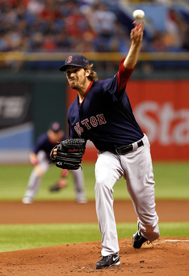 ST PETERSBURG, FL - JULY 15:  Pitcher Andrew Miller #30 of the Boston Red Sox pitches against the Tampa Bay Rays during the game at Tropicana Field on July 15, 2011 in St. Petersburg, Florida.  (Photo by J. Meric/Getty Images)