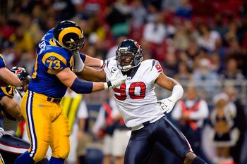 ST. LOUIS - DECEMBER 20:  Mario Williams #90 of the Houston Texans rushes against Adam Goldberg #73 of the St. Louis Rams at Edward Jones Dome on December 20, 2009 in St. Louis, Missouri.  (Photo by Dilip Vishwanat/Getty Images)
