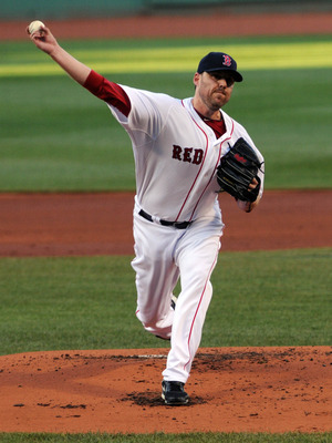 BOSTON, MA - JULY 09:  John Lackey #41 of the Boston Red Sox throws a pitch in the first inning against the Baltimore Orioles at Fenway Park on July 9, 2011 in Boston, Massachusetts. The Boston Red Sox won the game 4-0.  (Photo by Darren McCollester/Getty