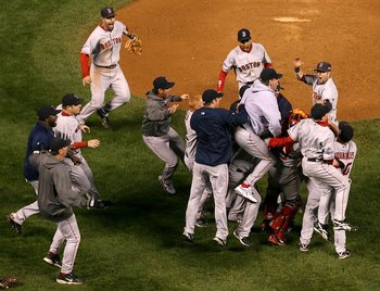 DENVER - OCTOBER 28:  (L-R) David Ortiz #34, Eric Hinske #12, Mike Lowell #25, Julio Lugo #23, Curt Schilling #38 and Dustin Pedroia #19 of the Boston Red Sox celebrate after defeating the Colorado Rockies in Game Four of the 2007 World Series at Coors Fi