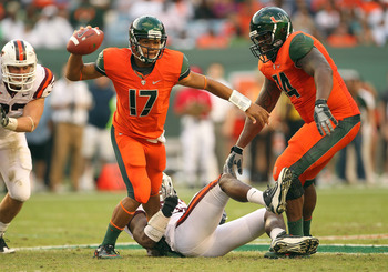 MIAMI - NOVEMBER 20:  Stephen Morris #17 of the Miami Hurricanes passes out of trouble during a game against the Virginia Tech Hokies at Sun Life Stadium on November 20, 2010 in Miami, Florida.  (Photo by Mike Ehrmann/Getty Images)