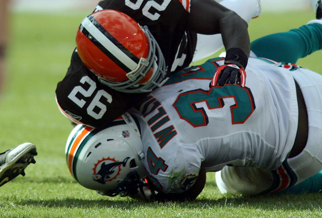 MIAMI - DECEMBER 05:  Running back Ricky Williams #34 of the Miami Dolphins is brought down by Abram Elam #26 of the Cleveland Browns at Sun Life Stadium on December 5, 2010 in Miami, Florida. Cleveland defeated miami 13-10. (Photo by Marc Serota/Getty Im