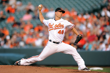 BALTIMORE, MD - JULY 14:  Jeremy Guthrie #46 of the Baltimore Orioles pitches during a baseball game against the Cleveland Indians at Oriole Park at Camden Yards on July 14, 2011 in Baltimore, Maryland   (Photo by Mitchell Layton/Getty Images)