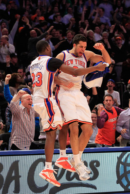 NEW YORK, NY - JANUARY 27:  Toney Douglas #23 celebrates with Landry Fields #6 of the New York Knicks after Landry shoots a three pointer against the Miami Heat at Madison Square Garden on January 27, 2011 in New York City. NOTE TO USER: User expressly ac