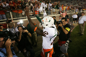 TALLAHASSEE, FL - SEPTEMBER 07:  Quarterback Jacory Harris #12 of the Miami Hurricanes celebrates victory over the Florida State Seminoles as he leaves the field at Doak Campbell Stadium on September 7, 2009 in Tallahassee, Florida. Miami defeated Florida