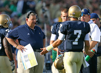 SOUTH BEND, IN - SEPTEMBER 19: Head coach Charlie Weis of the Notre Dame Fighting Irish talks with quarterback Jimmy Clausen #7 during a game against the Michigan State Spartans on September 19, 2009 at Notre Dame Stadium in South Bend, Indiana. (Photo by