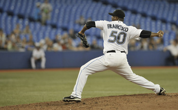 TORONTO, CANADA - JULY 20:  Frank Francisco #50 of the Toronto Blue Jays delivers a pitch during MLB game action against the Seattle Mariners July 20, 2011 at Rogers Centre in Toronto, Ontario, Canada. (Photo by Brad White/Getty Images)