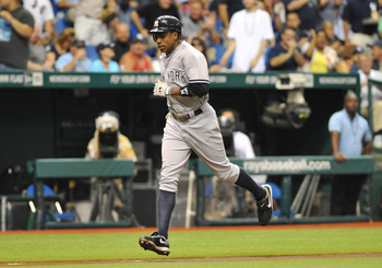 ST. PETERSBURG, FL - JULY 20:  Outfielder Curtis Granderson #14 of the New York Yankees scores on a first-inning home run against the Tampa Bay Rays July 20, 2011 at Tropicana Field in St. Petersburg, Florida.  (Photo by Al Messerschmidt/Getty Images)