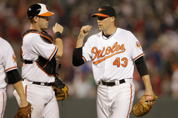BALTIMORE, MD - JULY 19: Catcher Matt Wieters #32 of the Baltimore Orioles (L) and relief pitcher Jim Johnson #43 celebrate the Orioles 6-2 win over the Boston Red Sox at Oriole Park at Camden Yards on July 19, 2011 in Baltimore, Maryland.  (Photo by Rob