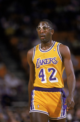 LOS ANGELES - 1988:  James Worthy #42 of the Los Angeles Lakers walks on the court during an NBA game at the Great Western Forum in Los Angeles, California in 1988. (Photo by: Stephen Dunn/Getty Images)
