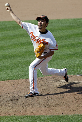 BALTIMORE, MD - JULY 17: Relief pitcher Koji Uehara #19 of the Baltimore Orioles delivers to a Cleveland Indians batter during the ninth inning at Oriole Park at Camden Yards on July 17, 2011 in Baltimore, Maryland. The Orioles defeated the Indians 8-3.(P
