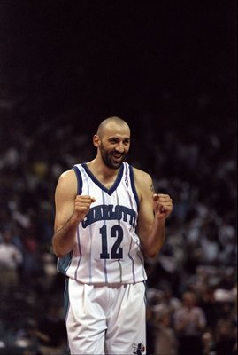 25 Apr 1998:  Vlade Divac #12 of the Charlotte Hornets celebrates during a first round Playoff Game against the Atlanta Hawks at the Charlotte Coliseum in Charlotte, North Carolina. The Hornets defeated the Hawks 92-85. Mandatory Credit: Craig Jones  /All