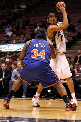 EAST RUTHERFORD, NJ - OCTOBER 20:  Eddie Curry #34 of the New York Knicks defends Brook Lopez #11 of the New Jersey Nets during the second half of a pre-season game on October 20, 2008 at the IZOD Center in East Rutherford, New Jersey. The Knicks won 114-