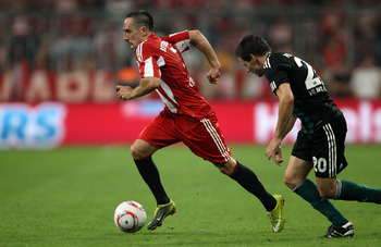 MUNICH, GERMANY - AUGUST 20:  Franck Ribery of Bayern is chased by Sascha Riether of Wolfsburg during the Bundesliga match between FC Bayern Muenchen and VfL Wolfsburg at Allianz Arena on August 20, 2010 in Munich, Germany.  (Photo by Clive Brunskill/Gett