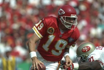 11 Sep 1994:  Quarterback Joe Montana of the Kansas City Chiefs (left) scrambles to avoid San Francisco 49ers defensive lineman Bryant Young during a game at Arrowhead Stadium in Kansas City, Missouri.  The Chiefs won the game, 24-17. Mandatory Credit: Mi