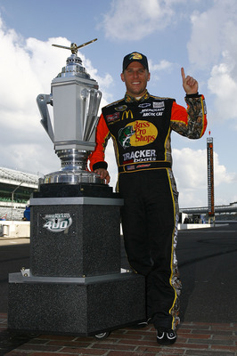 INDIANAPOLIS - JULY 25:  Jamie McMurray, driver of the #1 Bass Pro Shops/Tracker Boats Chevrolet, poses with the Brickyard 400 Trophy after winning the NASCAR Sprint Cup Series Brickyard 400 at Indianapolis Motor Speedway on July 25, 2010 in Indianapolis,