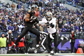 BALTIMORE, MD - DECEMBER 19:  T.J. Houshmandzadeh #84 of the Baltimore Ravens makes a catch that did not count for a touchdown when he was pushed out of bounds by Leigh Torrence #24 of the New Orleans Saints  at M&T Bank Stadium on December 19, 2010 in Ba