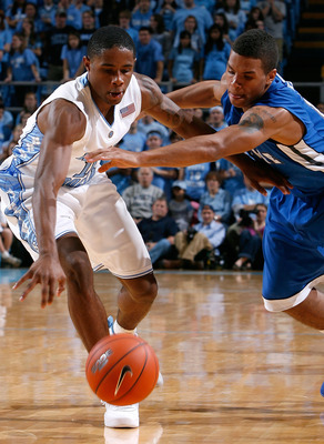 CHAPEL HILL, NC - NOVEMBER 30:  Larry Drew II #11 of the North Carolina Tar Heels steals the ball against J.P. Primm #10 of the UNC Asheville Bulldogs during the game at the Dean E. Smith Center on November 30, 2008 in Chapel Hill, North Carolina.  (Photo