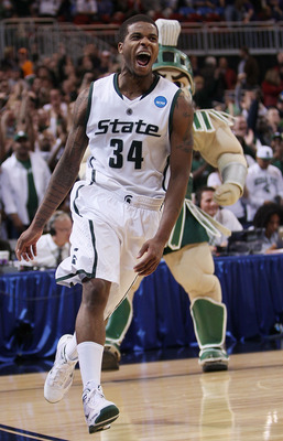 ST. LOUIS - MARCH 26:  Korie Lucious #34 of the Michigan State Spartans celebrates the win during the midwest regional semifinal of the 2010 NCAA men's basketball tournament at the Edward Jones Dome on March 26, 2010 in St. Louis, Missouri. Michigan State