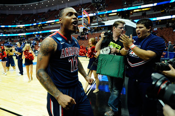 ANAHEIM, CA - MARCH 24:  Lamont Jones #12 of the Arizona Wildcats celebrates after defeating the Duke Blue Devils during the west regional semifinal of the 2011 NCAA men's basketball tournament at the Honda Center on March 24, 2011 in Anaheim, California.