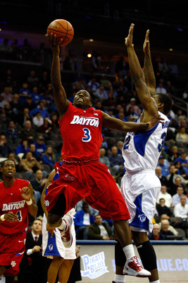 NEWARK, NJ - DECEMBER 22:  Juwan Staten #3 of  the Dayton Flyers drives for a shot attempt against Jeff Robinson #32 of the Seton Hall Pirates at Prudential Center on December 22, 2010 in Newark, New Jersey. Dayton won 69-65. (Photo by Chris Chambers/Gett