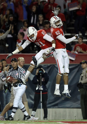 TUCSON, AZ - DECEMBER 02:  Wide receiver Juron Criner #82 of the Arizona Wildcats and David Roberts #81 celebrate after Criner scored a 28 yard touchdown reception against the Arizona State Sun Devils during the college football game at Arizona Stadium on