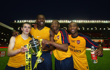 LIVERPOOL, ENGLAND - MAY 26:  (L-R) Arsenals Jack Wilshere, Jay Emmanuel Thomas, Sanchez Watt and Cedric Evina celebrate winning the FA Youth Cup during the second leg of the FA Youth Cup final sponsored by E.ON, between Liverpool and Arsenal at Anfield o