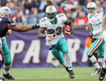 FOXBORO, MA - JANUARY 02:  Ronnie Brown #23 of the Miami Dolphins carries the ball in the first half against the New England Patriots on January 2, 2011 at Gillette Stadium in Foxboro, Massachusetts.  (Photo by Elsa/Getty Images)