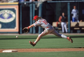 8 Apr 2000:  Mickey Morandini #12 of the Philadelphia Phillies runs to catch the ball during the game against the Houston Astros at Enron Field in Houston, Texas. The Astros defeated the Phillies 8-5. Mandatory Credit: Brian Bahr  /Allsport
