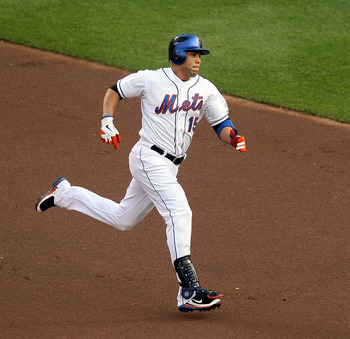 NEW YORK, NY - JULY 19:  Carlos Beltran #15 of the New York Mets runs out his first inning double against  the St. Louis Cardinals at Citi Field on July 19, 2011 in the Flushing neighborhood of the Queens borough of New York City.  (Photo by Jim McIsaac/G