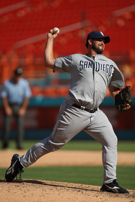 MIAMI GARDENS, FL - JULY 21: Heath Bell #21 of the San Diego Padres pitches in the ninth inning during a game against the Florida Marlins at Sun Life Stadium on July 21, 2011 in Miami Gardens, Florida. The San Diego Padres defeated the Florida Marlins 5-3